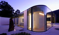 Between the Swiss Alps and Lake Lugano, Jacopo Mascheroni creates a rounded glass pavilion atop a submerged base. The polygonal glass pav Pavilion Architecture, Modern Architecture House, Lugano, Villa Design, House Design, Switzerland House, Green Magic Homes, Glass Pavilion, Glass House