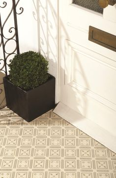 Pompeii tiles feature a tiny flower motif and symmetrical straight lines. Perfect on a pathway, hallway, cloakroom or confined space. Shown here in Dublin, Pompeii is also available in Indigo and Dark Blue, Black and Dark Grey on various background colours.