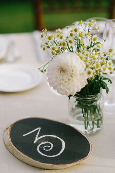 chalkboard table number // photo by Cinzia Bruschini white flowers, tabl number, chalkboard paint, chalkboard table numbers