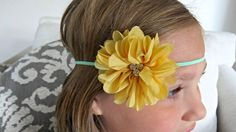 This cute handcrafted baby headband features a 2.5 chiffon flower in yellow on a 1/8 mint elastic. Perfect for photo props, special