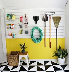 "Use a <a href=""http://go.redirectingat.com?id=74679X1524629&sref=https%3A%2F%2Fwww.buzzfeed.com%2Fmallorymcinnis%2Fshow-your-garage-who-is-in-charge&url=http%3A%2F%2Fwww.abeautifulmess.com%2F2014%2F06%2Fworkshop-space-organization.html&xcust=https%3A%2F%2Fwww.buzzfeed.com%2Fmallorymcinnis%2Fshow-your-garage-who-is-in-charge%7CBFLITE&xs=1"" target=""_blank"">slat wall</a> to hang and organize smaller accessories."