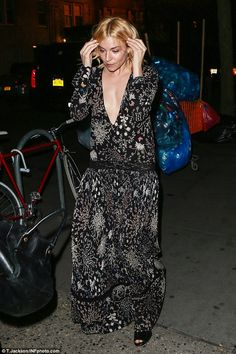 How low can you go? Sienna Miller looked ethereally beautiful in a super low-cut black floral dress, as she arrived at the SAG Foundation Conversations Screening and Q&A for new film Burnt in New York on Sunday