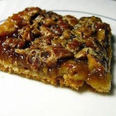 Crescent Pecan Pie Squares: 1 can crescent rolls, 1/2 c chopped pecans, 1/2 c sugar, 1/2 c corn syrup, 1 Tbsp butter/margarine, 1/2 tsp vanilla, 1 egg beaten