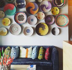 African Home Decor Catalog. African home decor gets its inspiration through nature. African Interior, African Home Decor, Ghana, Home Decor Catalogs, Deco Nature, Baskets On Wall, Beach Hotels, Orange And Purple, Plates On Wall