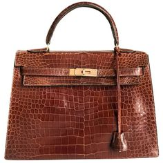 """Pre-owned """"""""Kelly Bag 32"""""""" made of crocodile leather (€12.800) ❤ liked on Polyvore featuring bags, handbags, brown, hermes purse, crocodile handbags, handbag purse, crocodile purse and croc handbags"""