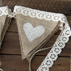 Easy Bunting. If use burlap or or other 'holey' material then could stitch on a message or pattern (or stencil). If use lace instead of binding then could use wee straps with press studs (like kind you get in good dresses to keep straps in place) to attach so could extend bunting when want to and adjust for occasion.