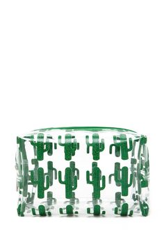 A clear boxy makeup bag featuring an allover glitter cactus print and a zipper top.