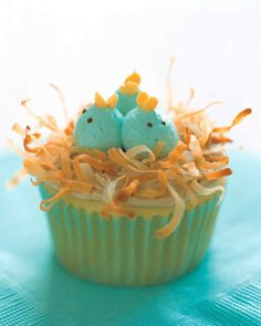 Nesting Baby-Bluebird Cupcakes | Martha Stewart Living - Delicious and adorable, these nesting baby-bluebird cupcakes are made from coconut, buttercream frosting, cake, and food coloring.