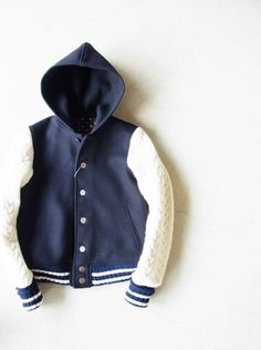 I am intrigued but wonder about the fit an wear on the sleeve seams. I would probably wear it.  Cicata Varsity Jacket with Cable-Knit Sleeves