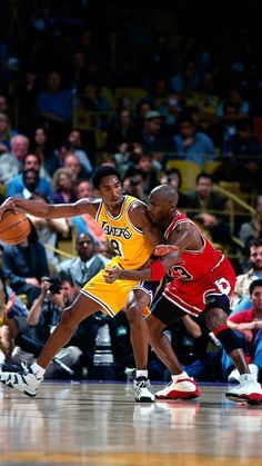 Kobe Bryant of the Los angeles Lakers keeps the ball away from Michael Jordan of the Chicago Bulls as he back in closer to the basket during an NBA game at The Great Western Forum in Inglewood, California Michael Jordan Basketball, Kobe Vs Jordan, Kobe Bryant Michael Jordan, Michael Jordan Dunking, Michael Jordan Poster, Lakers Kobe Bryant, Kobe Bryant Dunk, Michael Jordan Wallpaper Iphone, Kobe Bryant Iphone Wallpaper