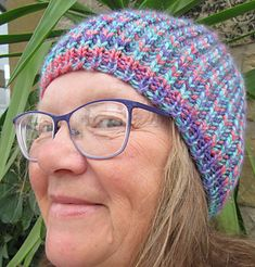 Fisherman's Rib gives a lovely warm fabric, ideal for a hat. This pattern is for a simple beanie/toque hat, which knits up quickly in Aran/Worsted weight yarn, and features a neat cast on edge. It is knit in the round.