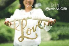 Glitter Love Dress Hanger DIY on Green Wedding Shoes.Maybe not glitter though. No craft herpes at my wedding, thank you very much! Diy Wedding Hangers, Wedding Dress Hanger, Diy Wedding Decorations, Diy Hangers, Clothes Hangers, Our Wedding, Dream Wedding, Wedding Beauty, Wedding Blog