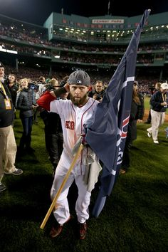 Dustin Pedroia #15 of the Boston Red Sox celebrates on the field following a 6-1 victory over the St. Louis Cardinals in Game Six of the 2013 World Series.