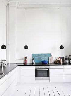 Stark black and white and no upper cabinets — perfect simplicity. | A Gallery of Minimalist Kitchens