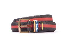 #2698 - Black and red belt from a spare race bicycle tyre, entirely handcrafted, iron branded and numbered. Strap folded up and stitched up with cotton colored strings.