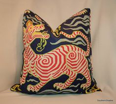The fabric is Tibet Print Navy by Clarence House (100% Linen -30.25 vertical repeat). The pictures of the pillow are for construction examples
