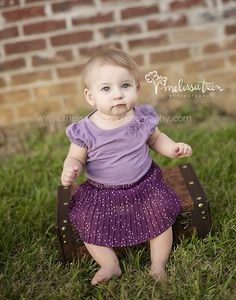 sweet baby pictures 8 months old girl in park outdoors sitting on old brown suitcase wearing purple tutu family photography cary north carolina apex hillsborough mebane portraitsbeautiful www.melissatreenphotography.com/blog