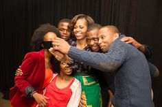 The First Lady poses with stage participants following a Google + Hangout on education at the Sci Bono Discovery Center in Johannesburg, South Africa.