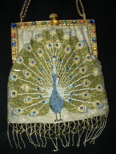 Meticulously handcrafted steel cut beaded Peacock Purse - Art Deco French Period 1920s.