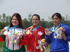 July 12 - Shooting - Results - Women's 10m Air Pistol - Final. Canada's Lynda Kiejko, centre, won the gold medal in women's 10-metre air pistol shooting on Sunday afternoon. She is flanked by silver medallist Alejandra Zavala, left, of Mexico, and El Salvador's Lilian Castro, who won bronze.