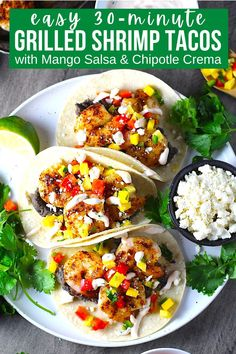 These 30-Minute Grilled Shrimp Tacos with Mango Salsa & Chipotle Crema are fresh, bright, and delicious. Succulent shrimp are seasoned with chili powder and cumin and then grilled to perfection. Then they are layered into corn tortillas with a bright, sweet and savory Mango, red pepper, and jalapeno salsa. Finally, as if this couldn't get any better, creamy Chipotle Crema and tangy Cotija cheese are added. #tacos #shrimprecipes #shrimptacos #30minutedinners Chipotle Crema, Jalapeno Salsa, Quesadillas, Burritos, Enchiladas, Side Dish Recipes, Healthy Dinner Recipes, Grilled Shrimp Tacos, Healthy Comfort Food