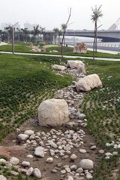 Taiyuan Fen River Waterfront Landscape Design | Tiayuan China | AECOM swale rocks boulders wsud sud water sensitive design urban design