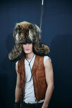 Giant fur trapper hat and fringed leather waistcoat backstage at Dsquared2 AW15 Milan. See more here: http://www.dazeddigital.com/fashion/article/23249/1/dsquared2-aw15