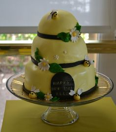 baby bee cake. I am thinking bee theme for her 1st birthday in July.