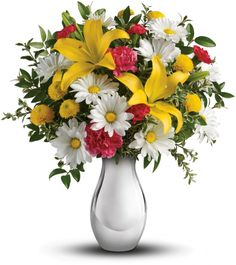 Imagine how tickled she'll be when this sweet bouquet comes her way! Arranged in our shimmering Silver Reflections vase - a gift she'll adore for years to come - this cheerful mix of golden lilies and crisp white daisies is a bright reminder of how much you care.