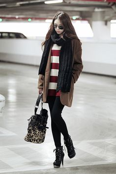it's summer in australia... and yet i can't stop looking at all these awesome winter outfits! i need to save up to buy more clothes for the coming winter!!  red striped sweater, brown coat, black scarf, black leggings and black laced up heels - warm and snuggly winter outfit!