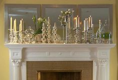 I LOVE these glass and metallic candlesticks in front of the mirrors. Stunning! | www.rappsodyinrooms.com