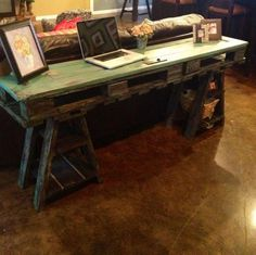 reclaimed wood desk table made from a vintage door and pallets via
