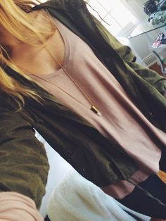 green cardigan over beige sweater (knitted)