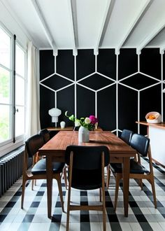 Love, love the black and white graphic dinning room wall and they way it looks with the beams and against the checkered floor. Well, the entire apartment is a delight full of graphics and light. Designed by Laurent Lo Monaco via marieclairemaison Dining Room Walls, Dining Room Design, Dining Chairs, Dining Table, Dining Room Inspiration, Interior Inspiration, Creative Inspiration, Style At Home, Sweet Home