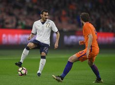 Davide Zappacosta of Italy competes for the ball with Daley Blind of Netherlands during the international friendly match between Netherlands and...