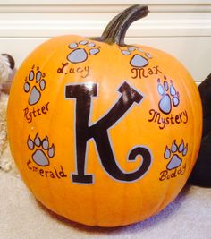 Monogram with paw prints painted pumpkin