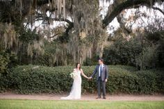 Sweetgrass Social wedding at Middleton Place. Whitney & Trey. Cute picture of bride and groom holding hands.