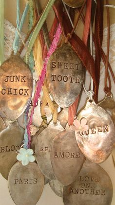 a bunch of vintage tarnished spoons & ribbon
