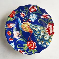 You'll feel proud to add our beautiful porcelain salad plate to your bright tablescape. Surrounded by vibrant colors and gorgeous blooms, the peacock is so stunning that you'll want to keep it out for display when not in use.