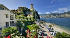 Hotel Castello Lake Front Malcesine Hotel Castello Lake Front is in Malcesine, overlooking Lake Garda. It offers panoramic lake views, and a private beach with parasols and deck chairs.