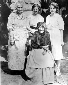 Four generations of Verdugo women, 1925. Senora Maria Verdugo de Chaugo with her daughter Senora Rafaela Urquidez, granddaughter Senor Maria Pettit and great-granddaughter Senorita Carlotta Pettit at the Verdugo Adobe. Glendale Central Public Library. San Fernando Valley History Digital Library.