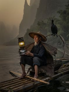 """Cormorant Fisherman"". A quasi studio portrait. Photo location:  Yangshuo, China. (Photo and caption by Carlos Ribas Monteiro/National Geographic Photo Contest)"