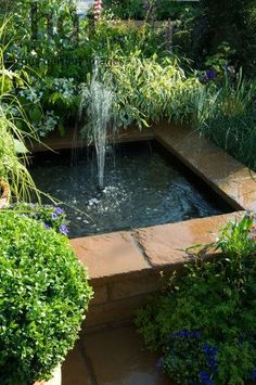 Harpur Garden Images Ltd :: 08MH210 Small square raised water feature pond pool fountain Design: Jeff Whiten Real Life by Bretts RHS Chelsea Flower Show 2008 Marcus Harpur