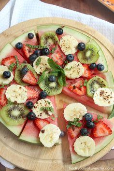 Watermelon Pizza with Passionfruit Yogurt ....watermelon, banana, strawberry, kiwi, blueberries, yogurt & passionfruit pulp ..optional: dark choc shavings & mint