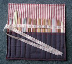 Knitting needle case - like the ribbon doing double duty as a tie and an upper half holder.
