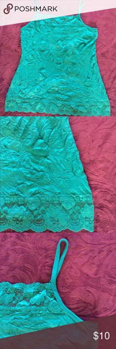 Turquoise Crinkle Cami NWOT crinkle cami from Maurices. Turquoise color. Lace accents. Pairs well with the tropical top in my closet as well. Size 1. Plus size. Maurices Tops Tank Tops