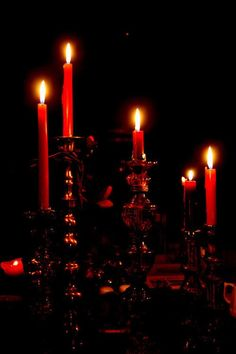 red candles in the dark