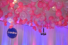 Fun ceiling full of balloons over a dance floor by Ideal Party Decorators - www.idealpartydecorators.com