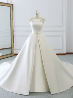 Silhouette:ball gown Hemline:floor length Neckline:bateau Fabric:satin Shown Color:white Sleeve Style:cap sleeve Back Style:lace up Embellishment:pearls