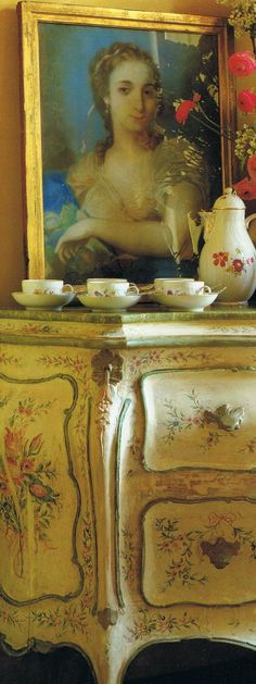 The lacquered flowered commode and simple gilded framed portrait    are 18th century Venetian, Royal Berlin tea service…